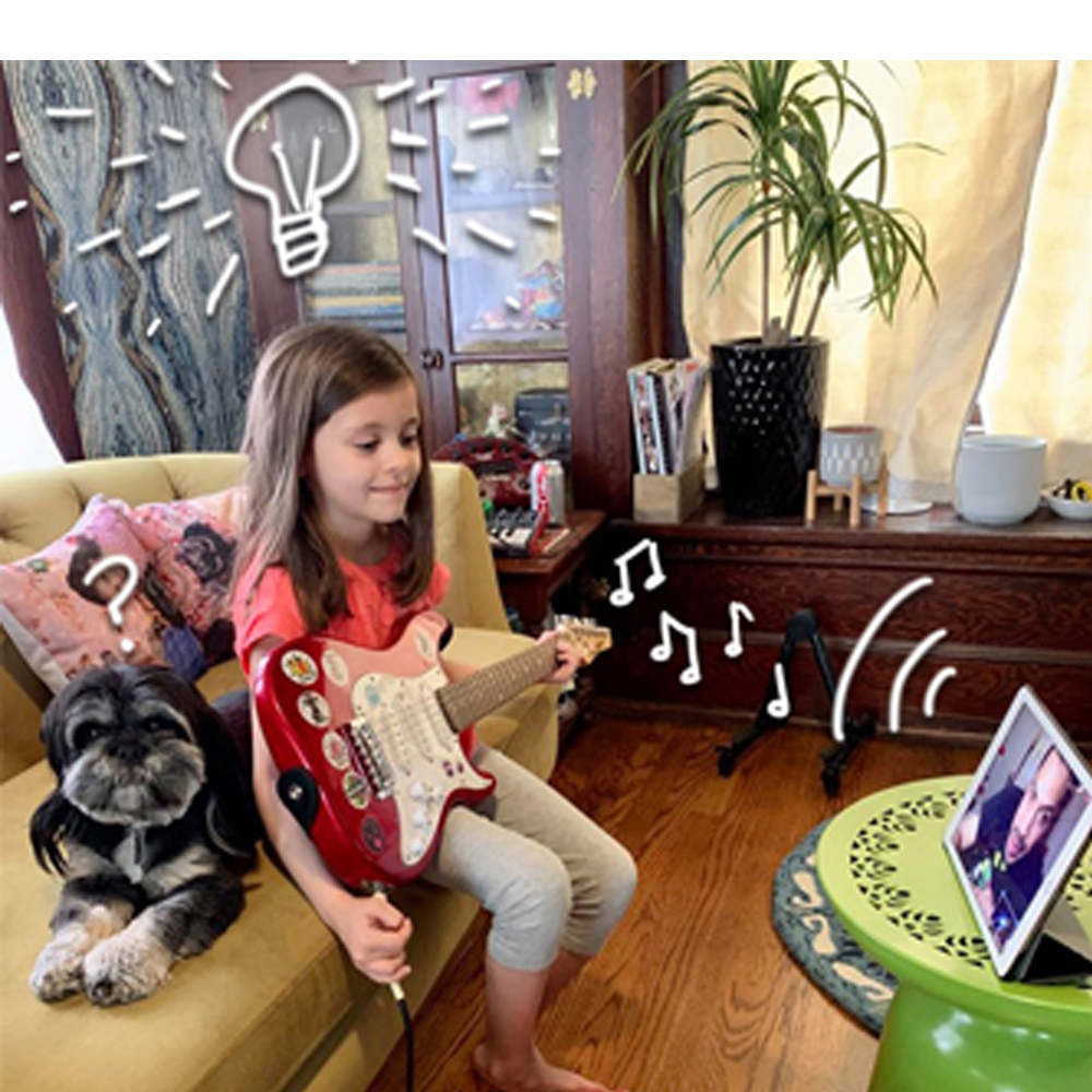 kid playing online guitar lessons